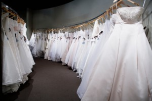 Row of wedding dresses hanging on rack